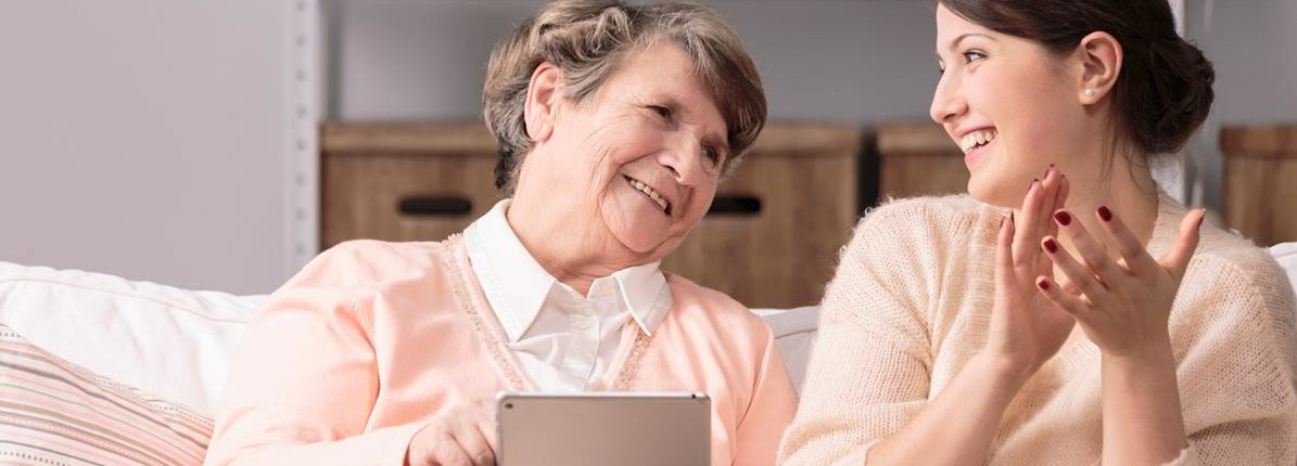 A picture showing elderly lady with carer